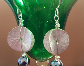 Wavy silver discs and hematite bead earrings