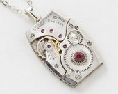 Steampunk Necklace Vintage Elgin watch movement pendant with ruby jewels, gears and red garnet crystal by Steampunk Nation
