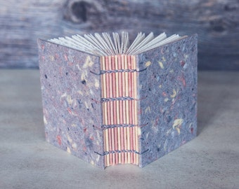 Chunky handmade book with speckled gray paper