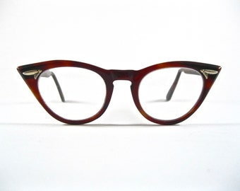 Tart Optical OTE cat eye glasses. 1950s tortoiseshell brown plastic frames.