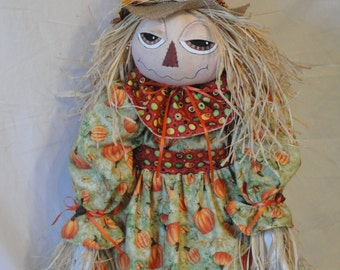 Primitive Scarecrow Girl Female Art Doll in yellow, green orange colors, all handmade by Morning Mist Designs