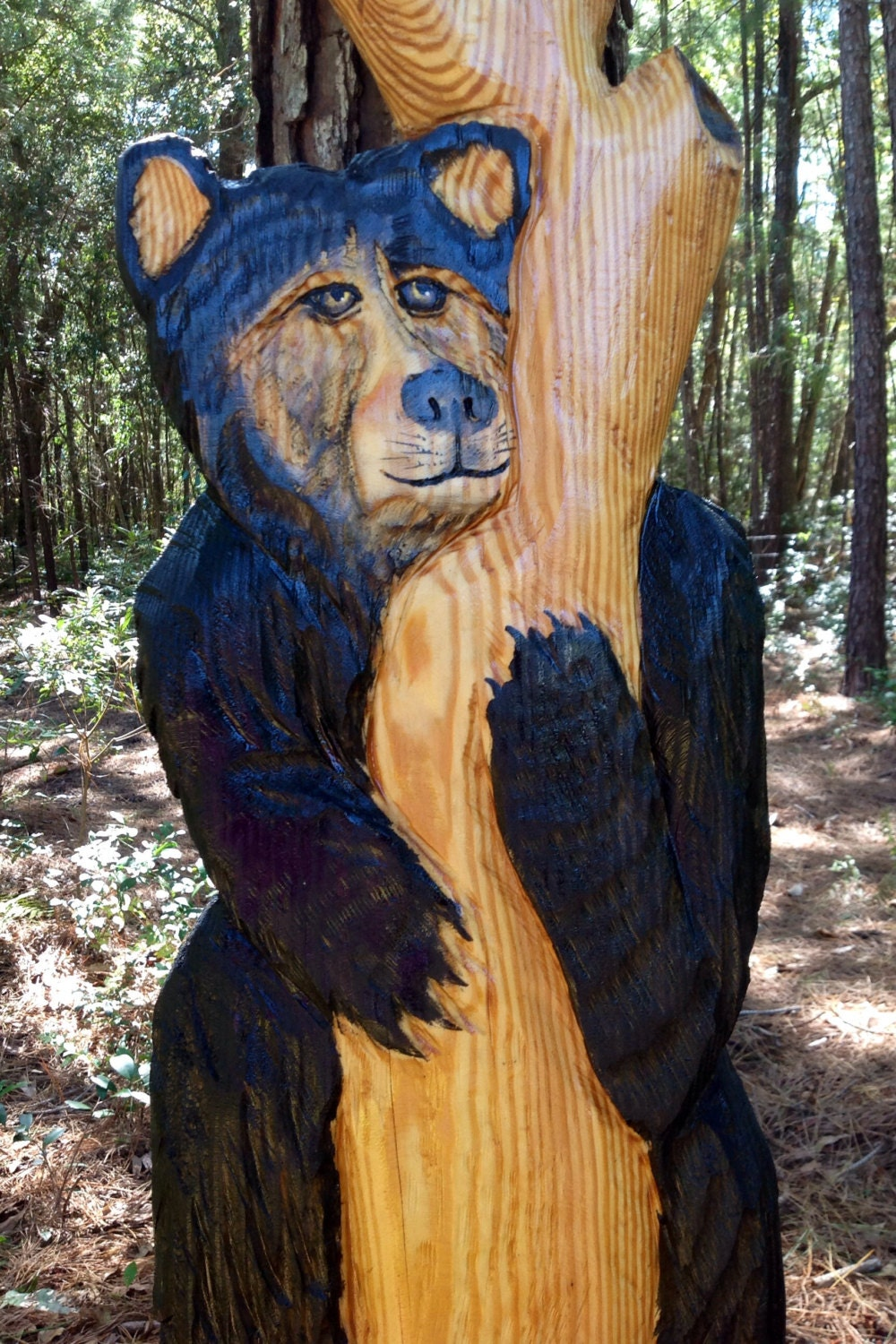 Black bear in tree chainsaw carving wooden wildlife