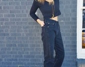 high waisted black rigid denim vintage levis 501s button fly long black straight leg jeans minimal grunge 90s witchy black denim jeans pants