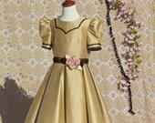 Flower girl dress shimmering gold with black and rose trim