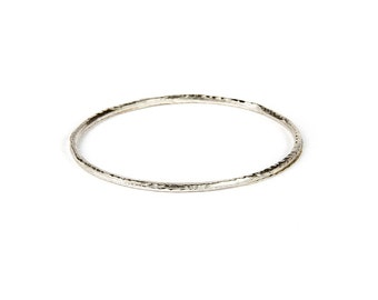 Forged sterling silver oval bangle