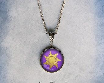 Rapunzel Sun  Etsy. Emperor Medallion. Alexander Medallion. Circular Medallion. Mens Silver Medallion. King Seiko Medallion. Png Medallion. Gold Coins Medallion. Neck Ribbon Medallion