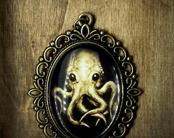 Yellow Cthulhu octopus necklace, horror, natural history, fantasy, scary