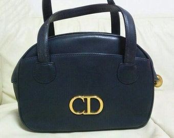 Vintage Christian Dior navy leather bolide style handbag with golden large CD logo. Classic style but rare design. Daily use.