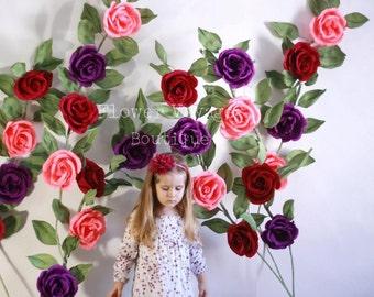 Giant paper flower display. Alice in Wonderland photo prop. Garden party backdrop. Rustic wedding arch decor