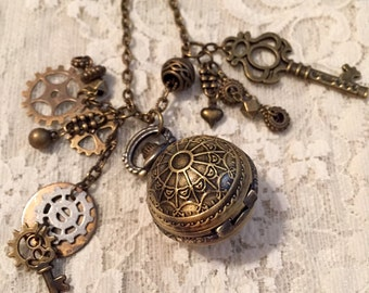 Small Pocket Watch Necklace With lots of Charms.  Antique Bronze Tone.