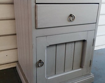 Rustic/country/french provincial style bedside table, painted grey with antique brass handles