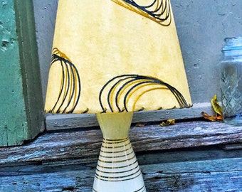 Medium sized 1950's fiber glass shade and ceramic abstract lamp base as is