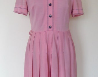Beautiful girly little sixties dress in baby pink with cute collar.  Eu size 40. Thick material, synthetic.