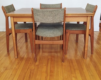 Danish Modern Teak Dining Table and chairs . Table with leaf . Mid Century Modern