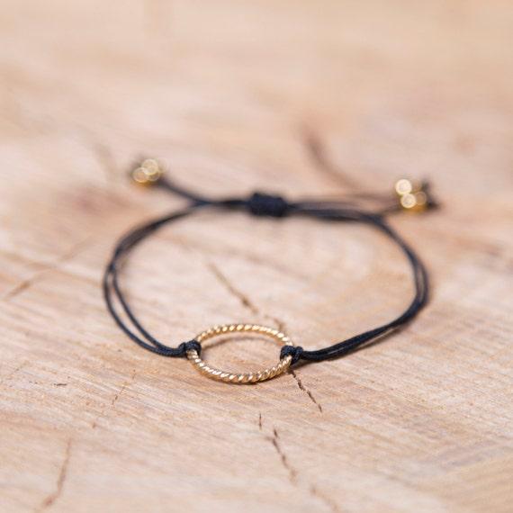 Charm bracelet on a nylon thread handmade in Montreal