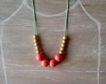 Chunky wooden bead necklace. 30mm wooden bead necklace.pink shiny wooden beads on a green suede cord