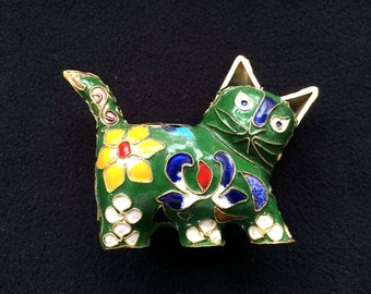 Vintage cloisonne green cat ornament decorated in orange, blue and white flowers