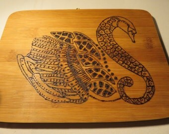 Hand crafted pyrography wood burned swan illustration