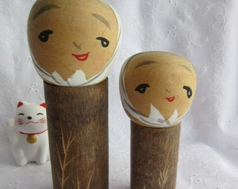 Small Kokeshi dolls in pair, a father and son, or two brothers, vintage, Japanese traditional wooden dolls
