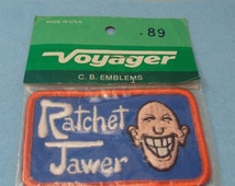 """New Old Stock Green Voyager Emblems CB Radio """"Ratchet Jawer"""" Patch"""