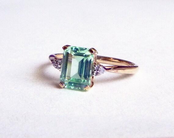 emerald cut light green gem accent 10k yellow gold