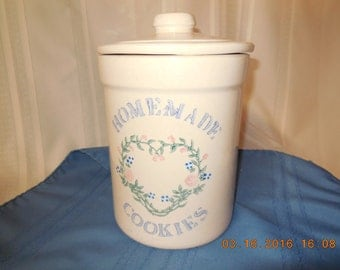Large stoneware cookie jar with lid.