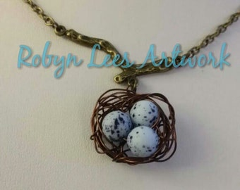 Bluebird's Egg Beads Bird Nest Necklace on Bronze Tree Branch and Bronze Crossed Chain