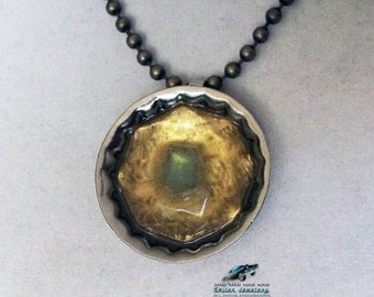 "Gold and green ""bottlecap"" necklace made with ""It's a Mad, Mad, Mad, Mad World"" car glass."