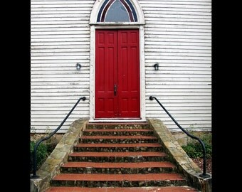 Bright Red Door Leads to Old Church Entrance