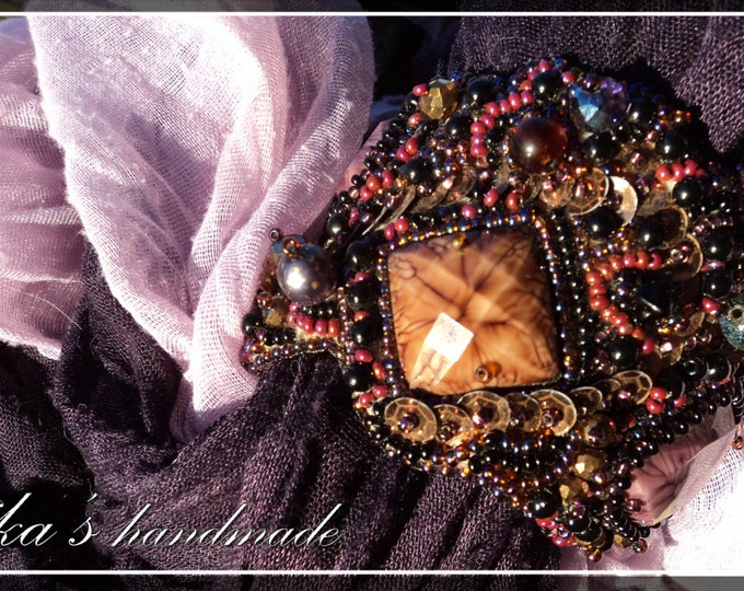Purple-black beaded bracelet with rhinestones, Czech crystals, sequins and big artificial plastic stones in the Gothic and Fantasy style