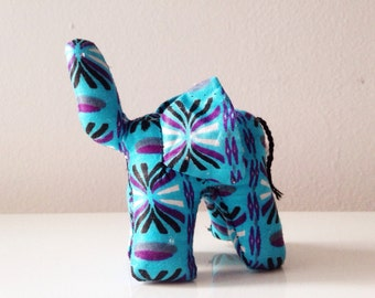 "Small Elephant #0118 made by Ugandan Disabled Women . 4"" height and 5"" wide"