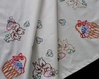 Vintage German handmade embroidered tablecloth -- bunny rabbits, Easter eggs and baskets -- from Germany