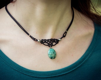 Lichens form with a short leather necklace and turquoise gemstone pendant