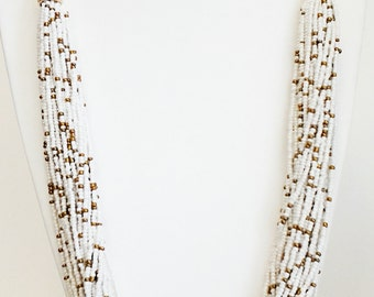 Beige and Copper Multi Strand Beaded Adjustable Suede Braid Necklace.