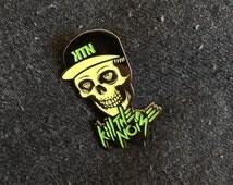 GLOW Kill the Noise Skull Pins, Heady Glow in the Dark Kill the Noise Diamond-Eyed Skull Hat Pin, Heady Glow-in-the-Dark KTN Skull Hat Pins