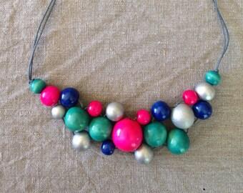 Fun fuchsia wooden bead bib necklace
