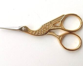 Cute golden bird scissors with a small tip