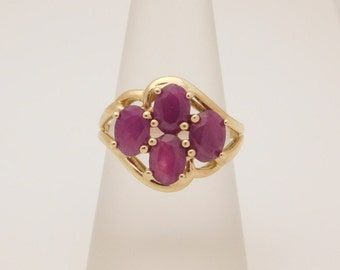Ladies Oval Cut Ruby Cluster Ring 10K