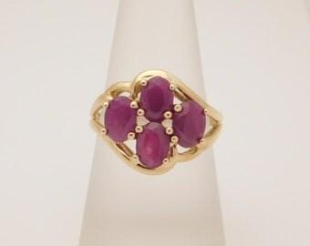Ladies Oval Cut Ruby Cluster Ring 10K