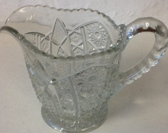 Decorative clear glass pitcher