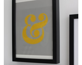 """Gray and yellow graphic. """"&"""""""