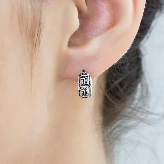 Sterling Silver huggie hoop earrings. silver hoop earrings.