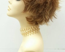 Short Layered Flip Wig with Dark Butterscotch Blonde Color and Dark Roots. Heat Resistant Wig. Fashion Wig. [35-191-Izzy-TT24/27]