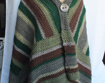 Poncho, wrap with large fixed button hand-crocheted in muted shades of green and brown acrylic yarn.