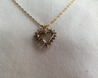 10k diamond heart pendant and necklace. #654