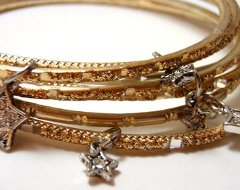 Stardust Charm Bangles - Seven gold and silver glitter metal bangles with Swarovski crystal star elements