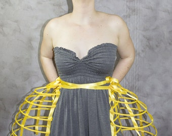 Two pieces worn together double pannier yellow ribbon and lacing Crinoline long cage hoop bustle