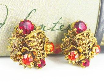 Stunning vintage antique gold filigree clip earrings with amazing detailed design and rich red and dark orange prong set crystals