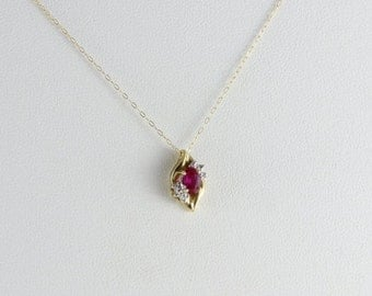 10k Yellow Gold Ruby andDiamond Necklace 18 inch chain