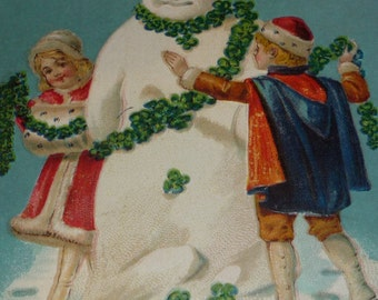 Children Decorate Snowman With Lucky Clovers Antique New Year Postcard